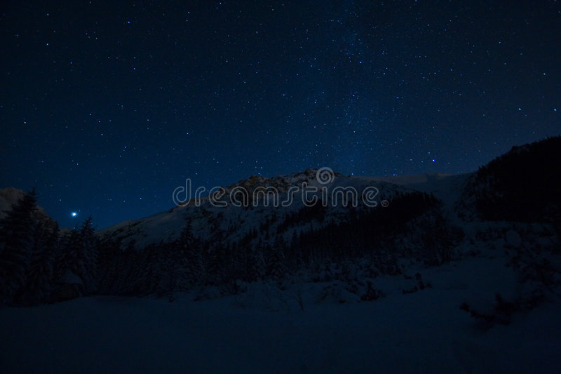 Starry night in mountains royalty free stock images