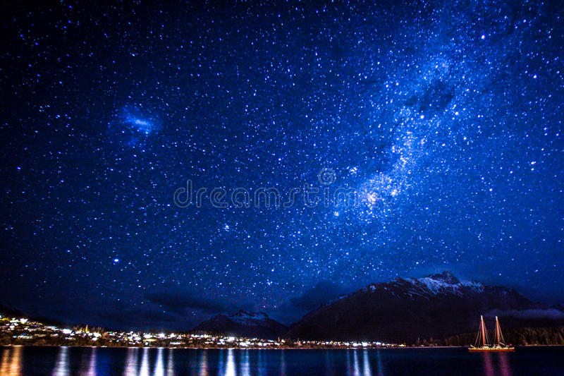 Starry Night in Queenstown. A view of stars in the sky above the city of Queenstown, New Zealand stock photos