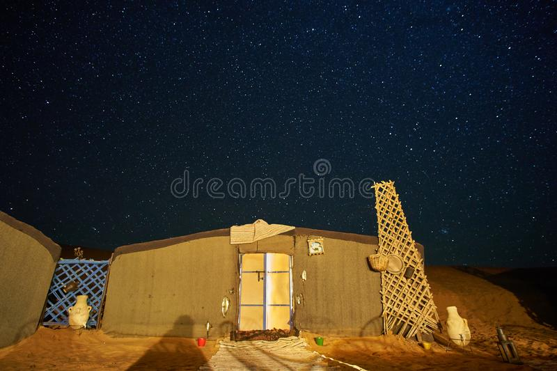 Starry night sky above the tent in a desert campsite stock photography
