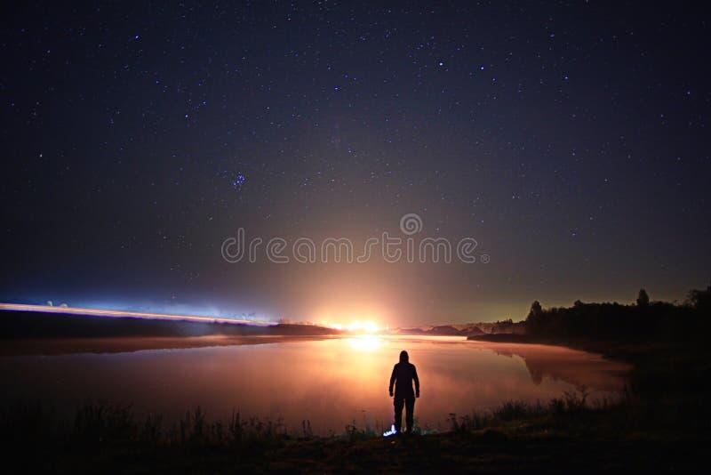 Starry night sky lake landscape stock photo