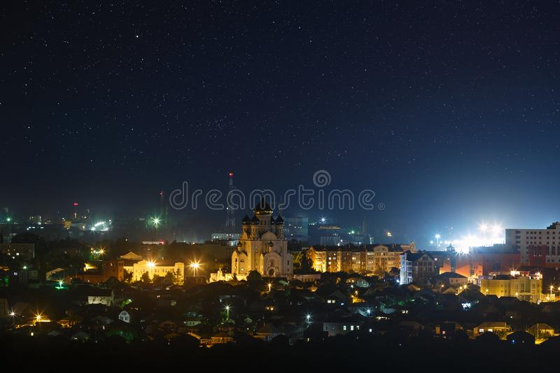 Starry night sky over the city. stock image
