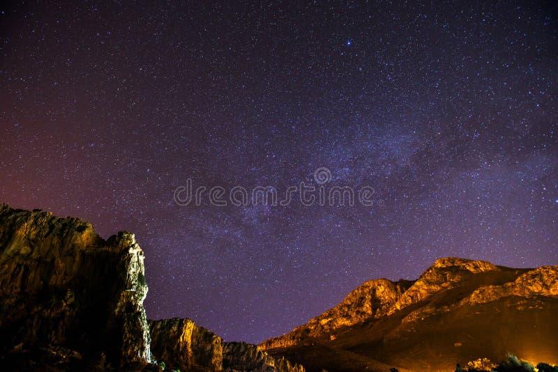The starry sky above rocky dolomite. The starry sky above rocky mountain, astrophoto stock image