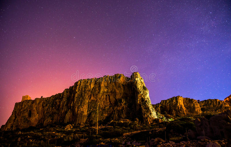 The starry sky above rocky mountains. The starry sky above rocky mountain, astrophoto stock image