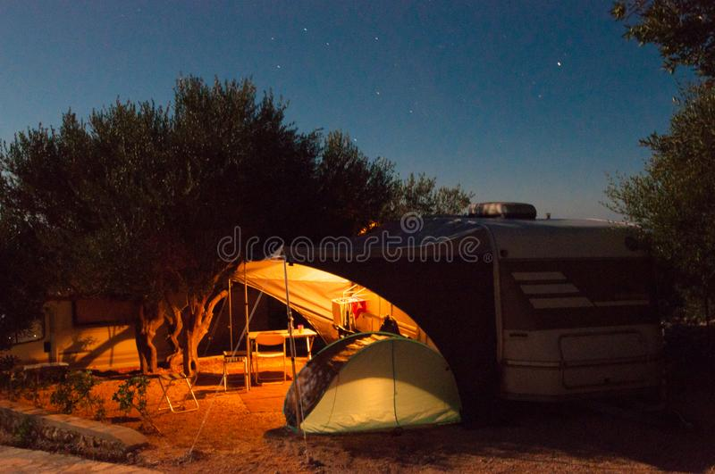 Download Camping By Night Illuminated Caravan Stock Image