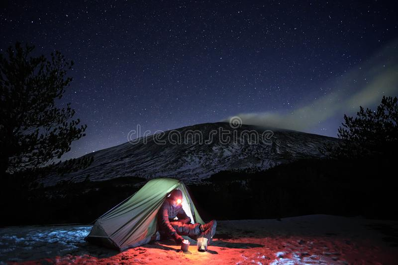 Starry Sky On Man And Tent In Winter Etna Park royalty free stock photos