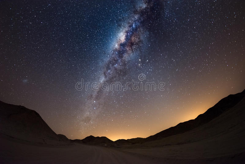 Starry sky and Milky Way arc, with details of its colorful core, outstandingly bright, captured from the Namib desert in Namibia, royalty free stock photos