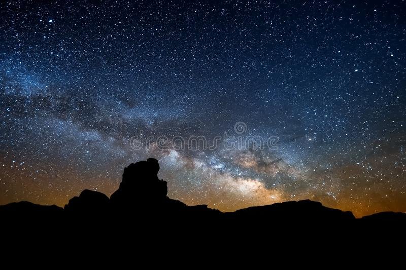 The starry sky, the milky way. Photo of long exposure. Night landscape royalty free stock photography
