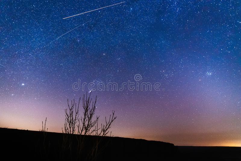 Starry sky at night in the steppes. Of the Rostov region, Russia with tracks from airplanes stock image