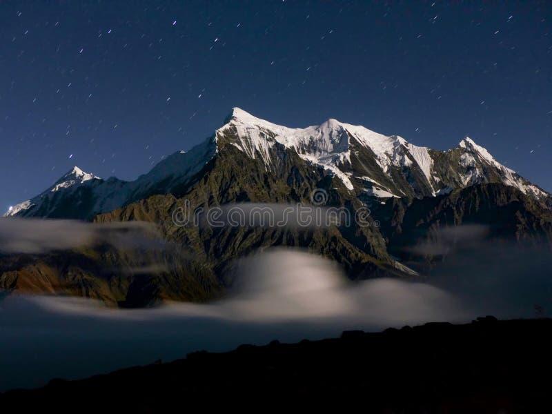 Starry sky over the Himalaya. Mount Nilgiri - Starry night on Annapurna Circuit trek in Nepal stock photo
