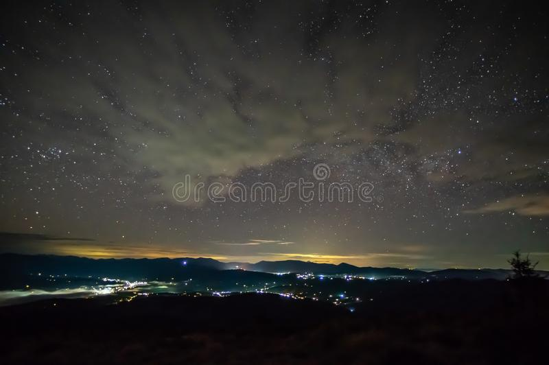 Starry sky over the city in the fog royalty free stock images