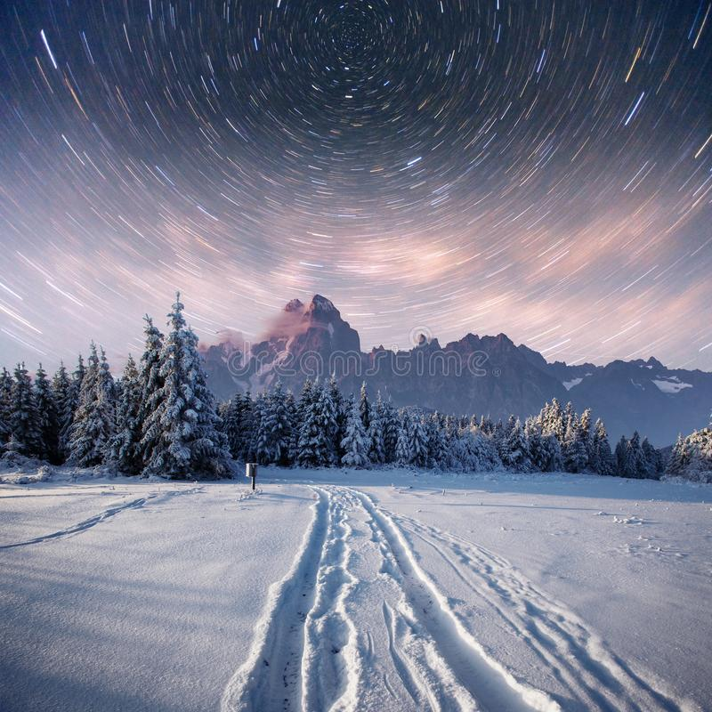 Starry sky in winter snowy night. fantastic milky way in the New Year`s Eve. In anticipation of the holiday. Dramatic. Scene. Carpathian. Ukraine stock photo
