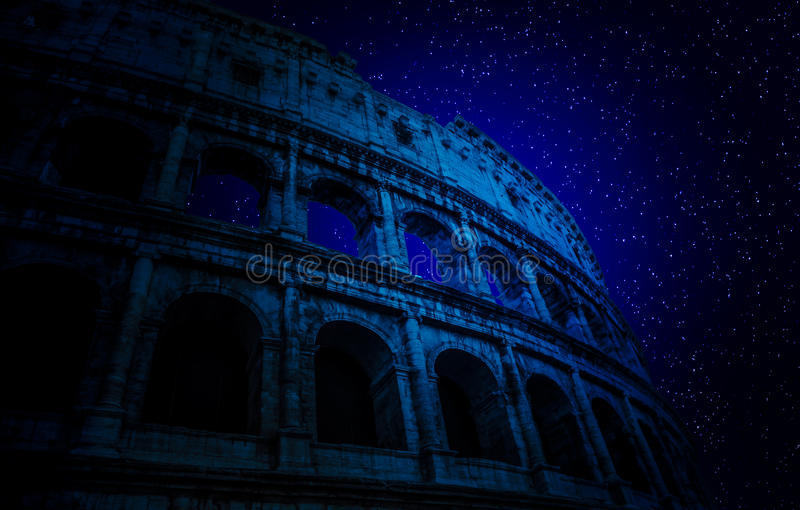 Stars above Colosseum stock photography