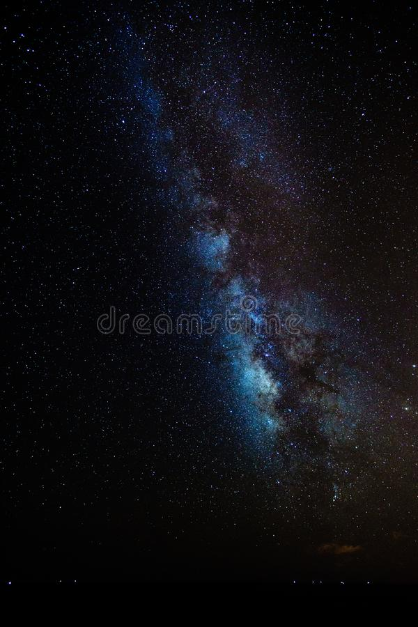 Stars against the dark sky in the pacific ocean showing the milky way. At summer stock images