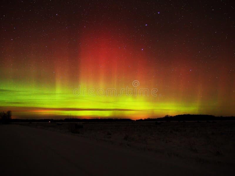 Aurora borealis northern polar lights and night sky stars. Aurora polar lights and stars in the night sky royalty free stock photo