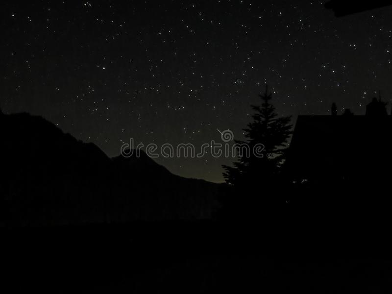Stars behind the mountains royalty free stock photography