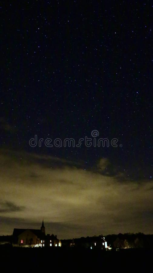 Starry sky over small rural town in french contryside stock photos