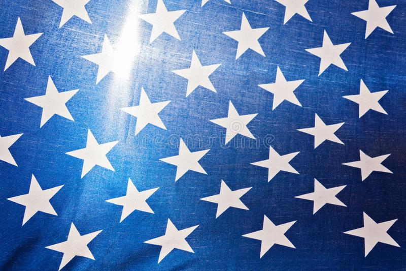 Stars on blue background as fragment of United States of America flag, closeup royalty free stock photos