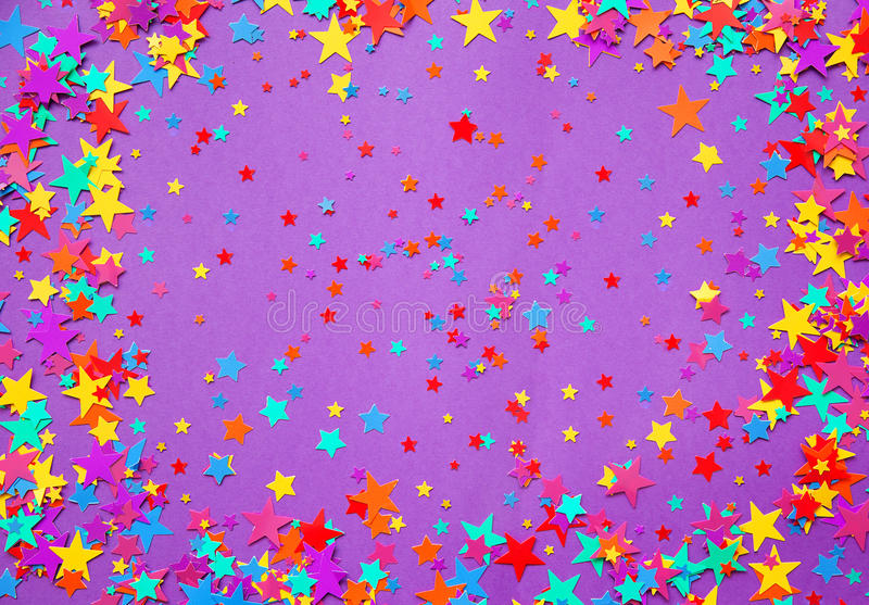 Stars confetti on a purple background royalty free stock photography