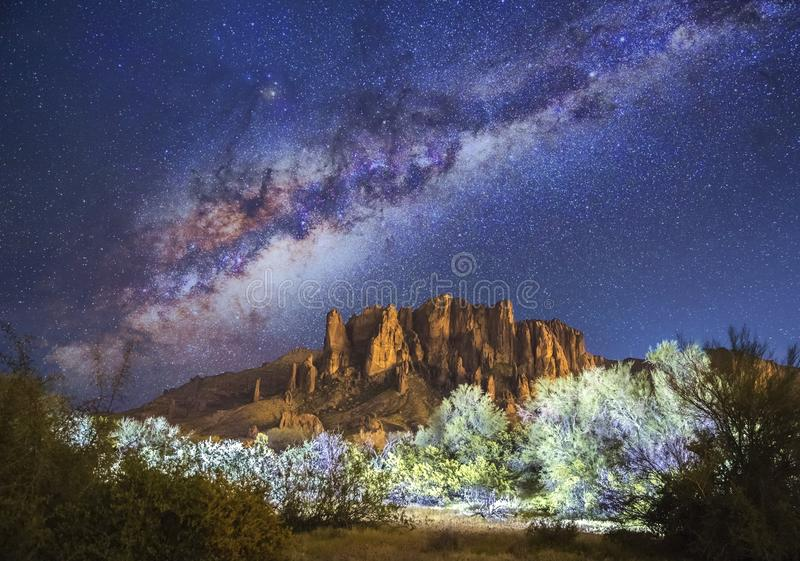 Stars & Milky Way over Superstition Mountains in Arizona. Stars & galaxy over Superstition Mountains in Arizona. Picture taken at Lost Dutchman, a State Park royalty free stock image