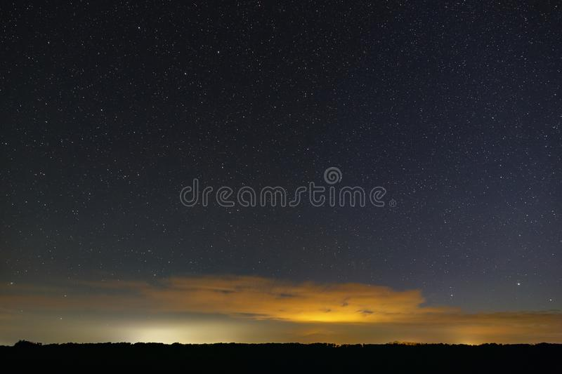 Stars of the Milky Way in the sky at night. Outer space and clouds. Photographed with a long exposure.  royalty free stock image