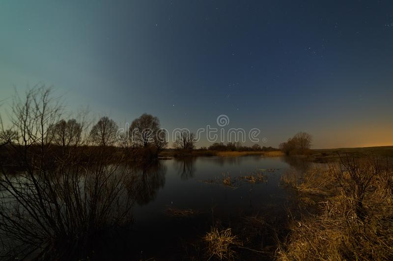 Stars in the night sky over the river. Early spring in central Russia.  royalty free stock images