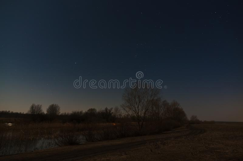 Stars in the night sky over the river. Early spring in central Russia.  royalty free stock image
