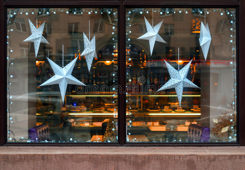 Stars of paper in the window of a cafe. royalty free stock photos