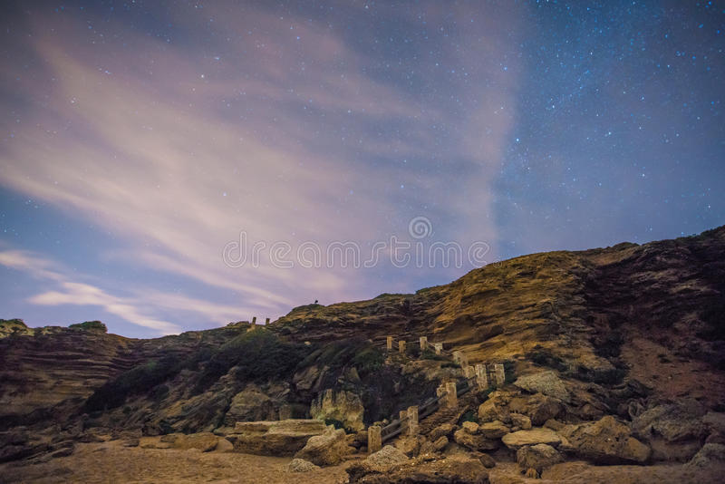 The stars in a perfect night in a beach stock photo