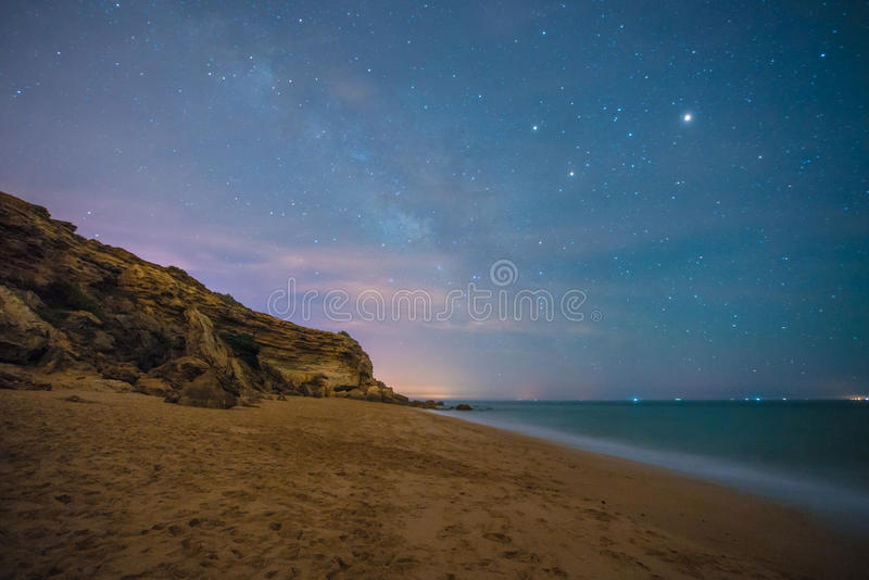 The stars in a perfect night in a beach royalty free stock photography
