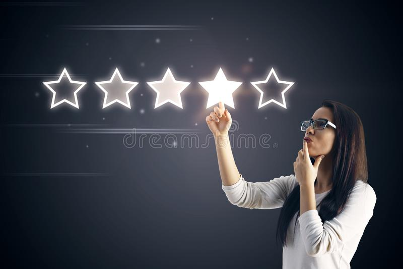 5 stars rating with businesswoman royalty free stock image