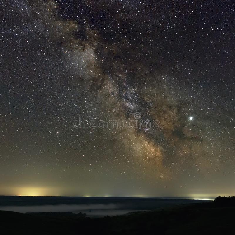 Stars in the sky at night. Bright milky way over the horizon with fog. Photographed with a long exposure.  stock photo