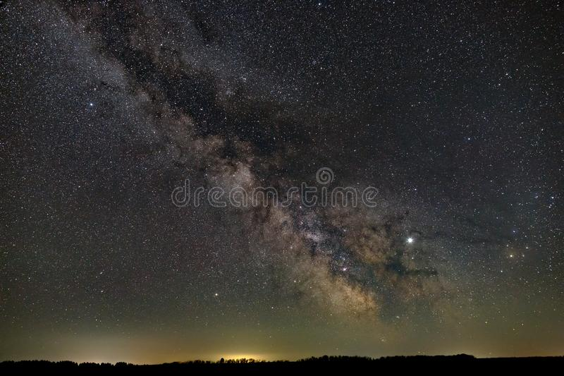 Stars in the sky at night. Bright milky way over the horizon. Photographed with a long exposure.  royalty free stock photo