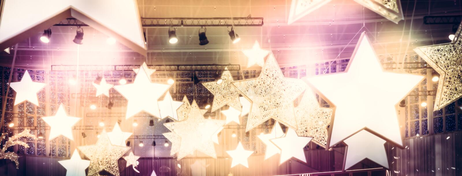 Stars spotlights soffits as finest hour celebrity show stage performance background with golden pink lights stock image