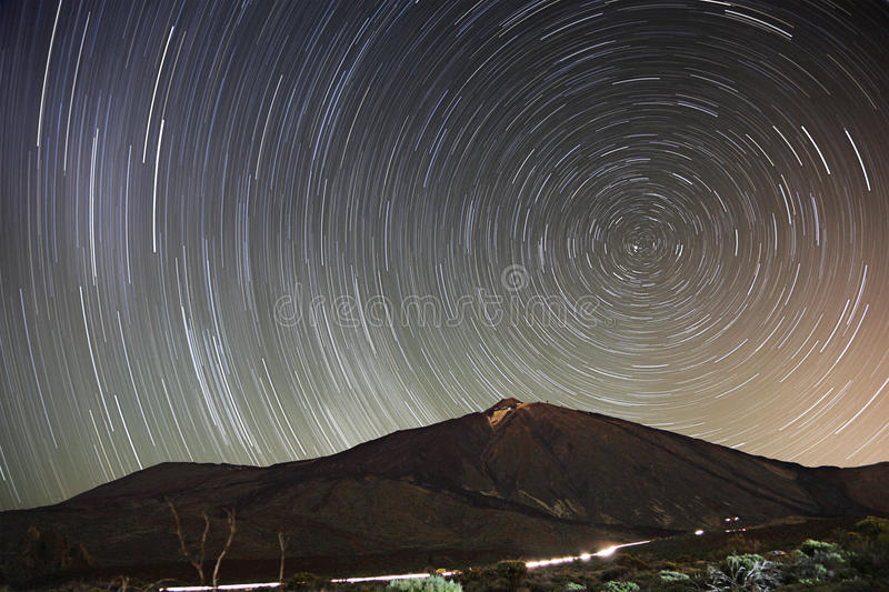 Stars - Star trail night sky, Teide, Tenerife. Stars. Star trail night sky on Teide, Tenerife. 65 min long exposure of a remarkable star clear night sky with royalty free stock image