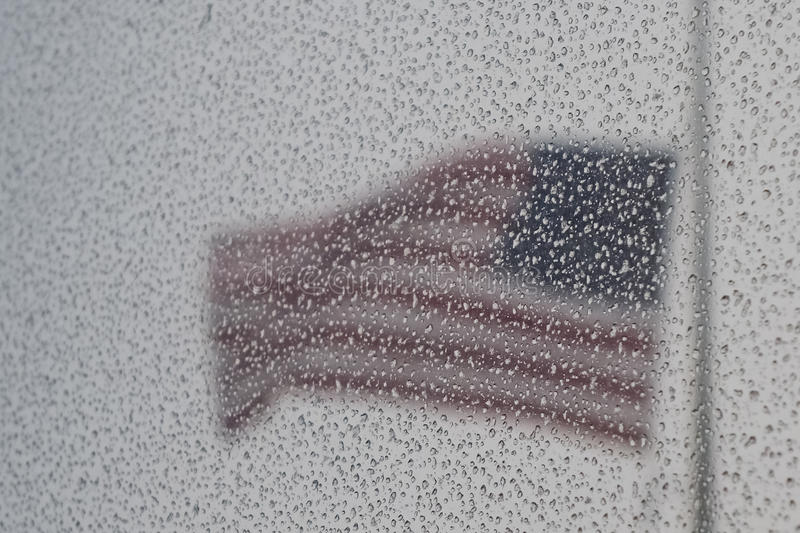 Stars and stripes in a storm stock images