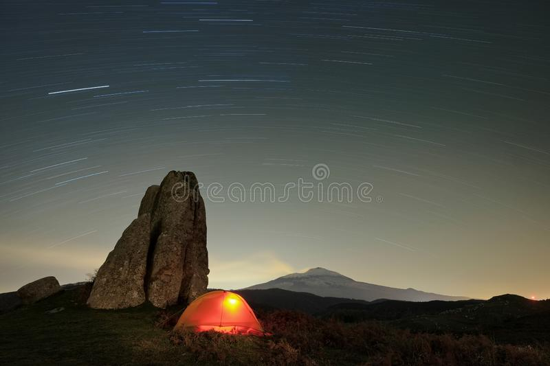 Stars Trails On Lighting Tent In Argimusco Highland, Sicily royalty free stock images