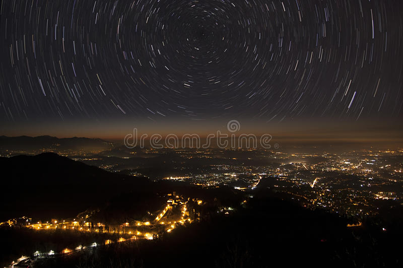 Stars trails and city royalty free stock image