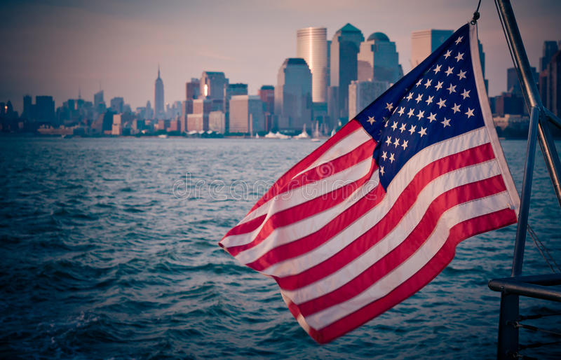 The starsprangled banner, american flag. The american flag with Manhattan in the background royalty free stock images