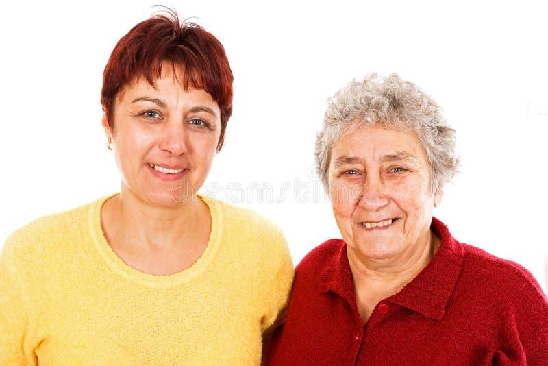 Starsza kobieta i potomstwo opiekun zdjęcia stock