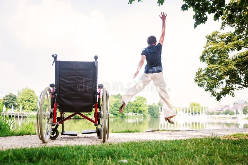 Starsza kobieta Skacze Up Od wózka inwalidzkiego obraz royalty free