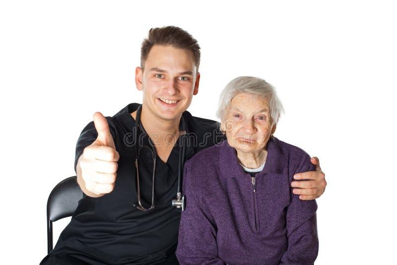 Starsza kobieta z opiekunem na odosobnionym zdjęcia royalty free