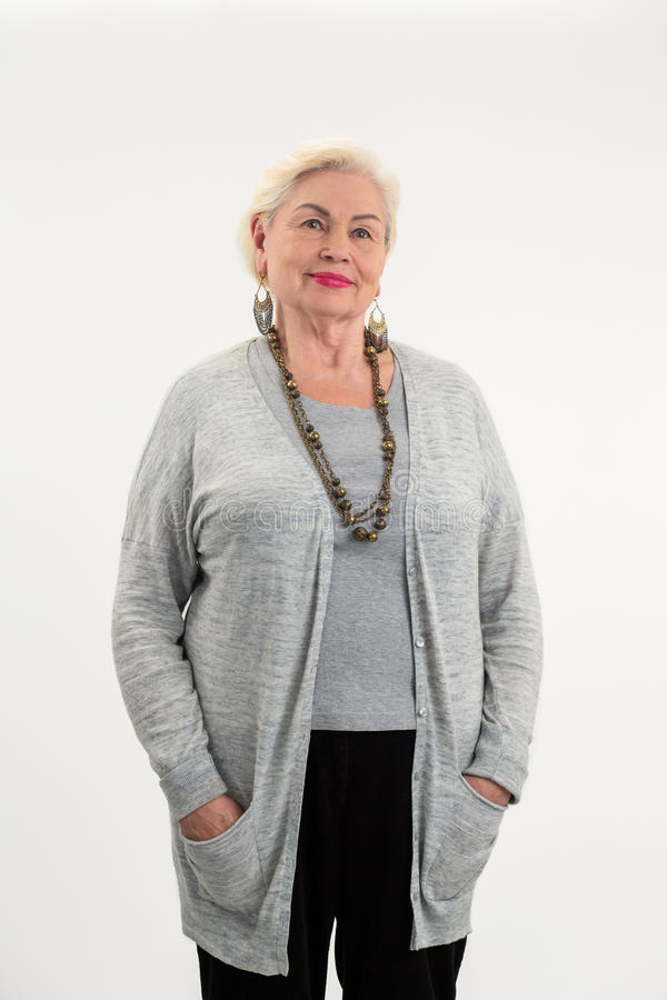 Starsza kobiety pozycja odizolowywająca zdjęcia royalty free
