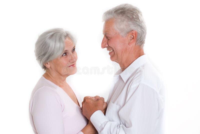 Starsze osoby dobierają się wpólnie zdjęcia stock