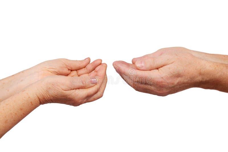 Starsze ręki pokazywać rączka rondla gest zdjęcia royalty free