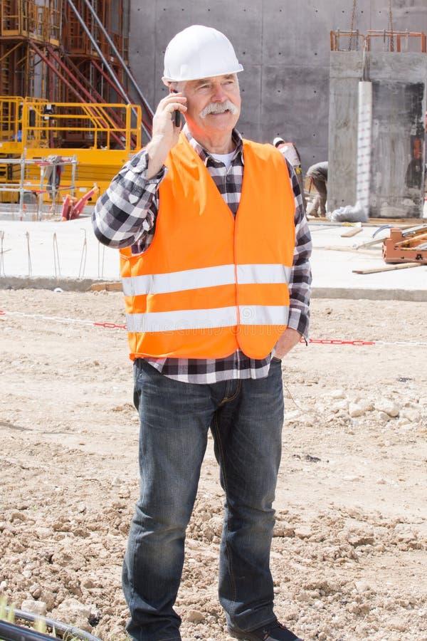 Starszego inżyniera budowniczy przy budową fotografia royalty free