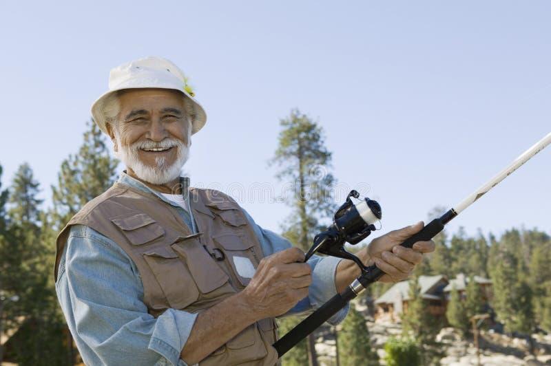 Starszego mężczyzna połów zdjęcie royalty free