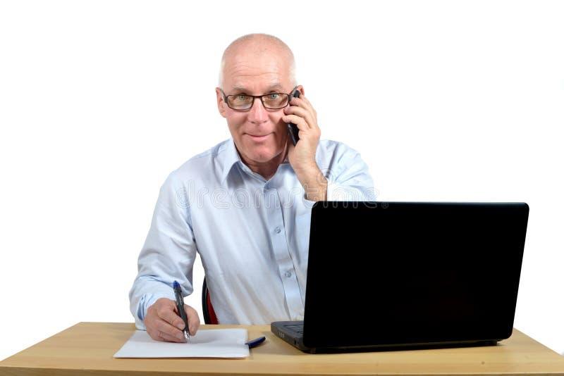 Starszy biznesmen w biurze obrazy stock