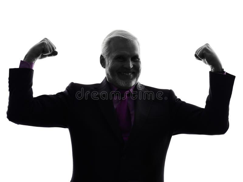 Starszy biznesowy mężczyzna napina mięsień silną sylwetkę fotografia royalty free