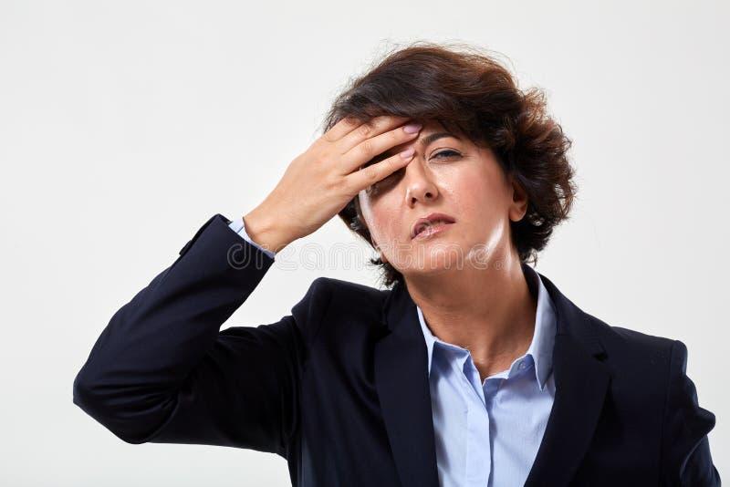 Starszy bizneswoman z migren? zdjęcia royalty free