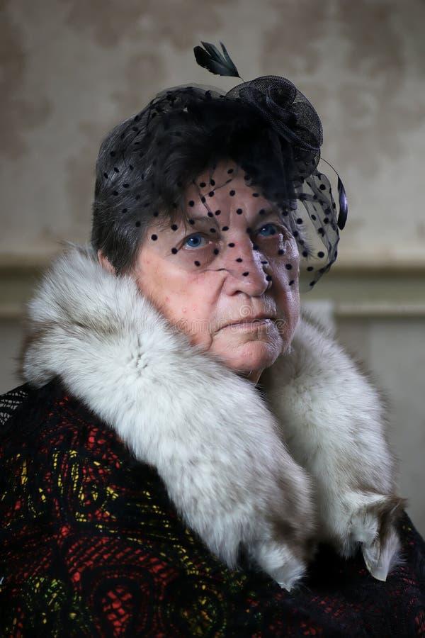 Starszy kobieta kapelusz retro obrazy stock